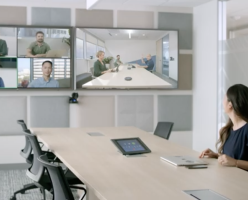 Woman in conference room on video call